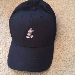 A black hat. Sporty. Disney. Nike dri-fit
